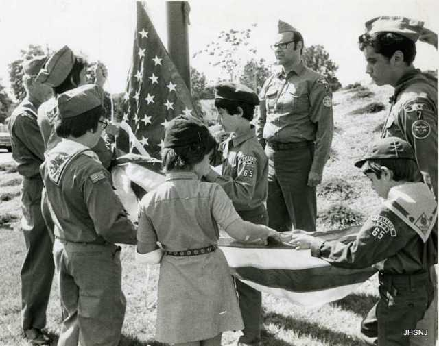 "Local scouts raising the flag at the dedication of the Wayne ""Y""., 1976"